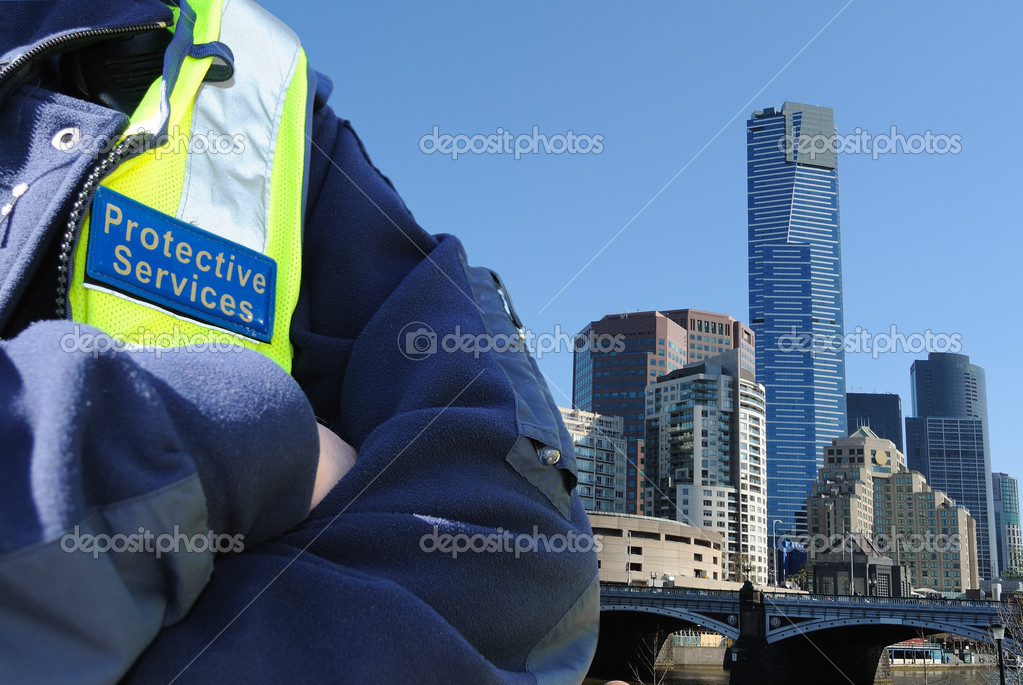 Security agent conducting surveillance and control of urban space