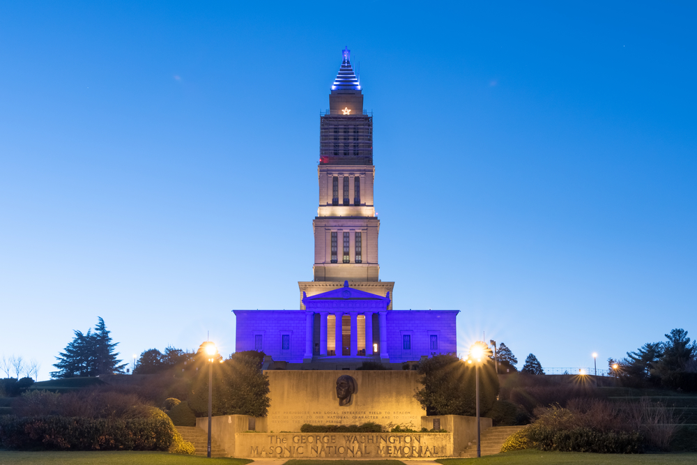 The George Washington Masonic National Memorial in Alexandria VA, USA.  Seen here at Dusk on a winter night with the blue lights illuminating the building.
